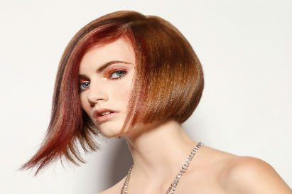 Redhead woman with stylish, modern hair style