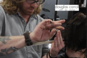 Stylist cutting a client's hair